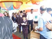 MEMBERS OF THE KERELA CLUB GIVING AWAY SNACKS AND STATIONARY ITEMS