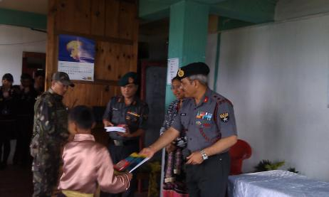 BRIG MONISH DISTRIBUTES THE STATIONARY TO STUDENTS
